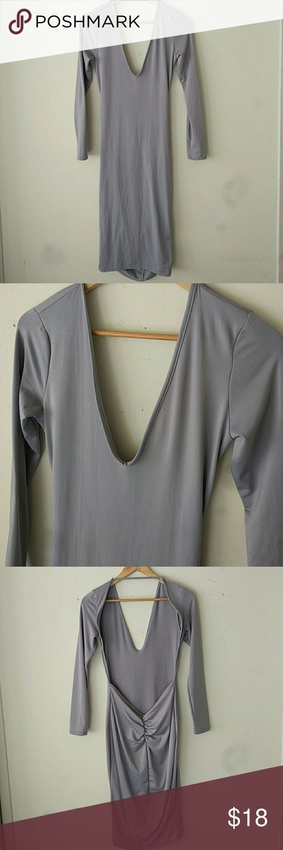 Pastel Purple Dress Like new. Great condition.  Pastel purple skin tight dress with open back and 3/4 sleeves.  Polyester/Spandex/cotton Dresses Backless