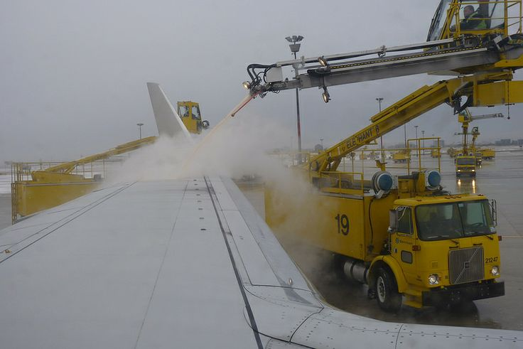 De-Icing an American Airlines Airplane at Toronto International Airport in Bad Weather in February, 2010