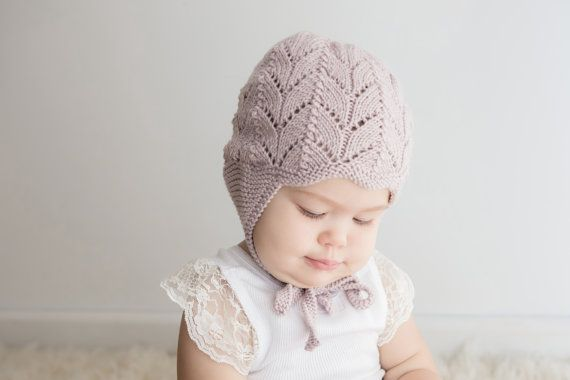 You are purchasing a PDF file to make your own little dover & madden Clover hat.    Clover is a gorgeous little lace ear flap hat knitted with