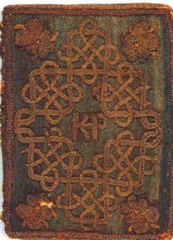 A gift from Elizabeth I to Queen Katharine Parr, Henry VIII's last wife.  Elizabeth's embroidery of her translation of the French poem The Mirror of the Sinful Soul, 1544  It is bound in blue cloth and embroidered with silver thread. Katharine Parr's initials appear in the center of the cover.