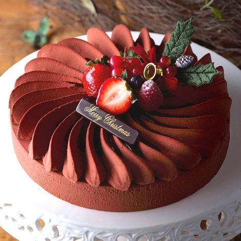 Résultats de recherche d'images pour «The perfect harmony of smooth and rich dark chocolate mousse, light chocolate genoise laced with dark rum, with a delicately crisp hazelnut fuellitine and almond succes biscuit.»