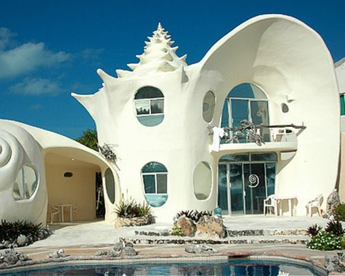 """Seashell house  ...I kinda like it.  I could imagine this being in a Fellini movie, or if """"Sunset Boulevarde"""" was set underwater, this is where Norma Desmond would live."""