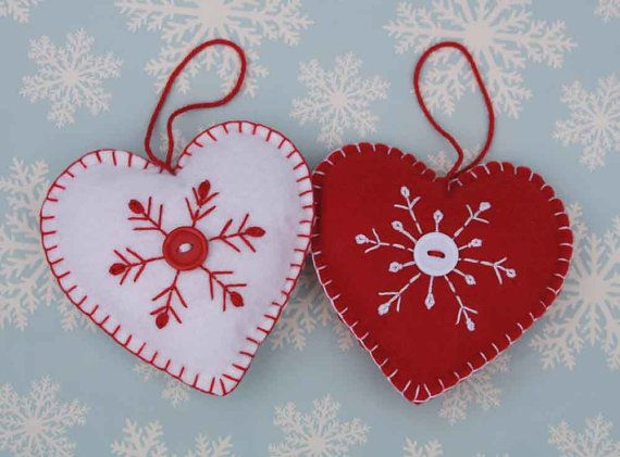Red and white felt Christmas heart ornament.  Handmade red and white Scandinavian style Christmas heart decoration, Hand embroidered snowflake design with button detail, blanket-stitched edges and a loop for hanging.  9.5cm high.  Red background with white embroidery and button.  You can see more Scandi style heart ornaments here; https://www.etsy.com/ie/shop/PuffinPatchwork?ref=hdr_shop_menu&section_id=19324374