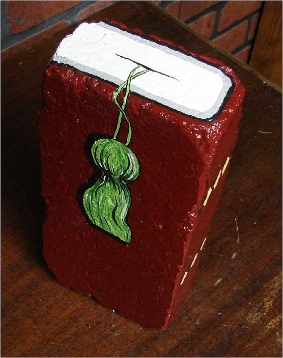 This is a heavy brick hand-painted as a book with tassel. It is dark maroon/burgundy and weighs 7 lbs., 15 oz. It is made as a companion book to the dark