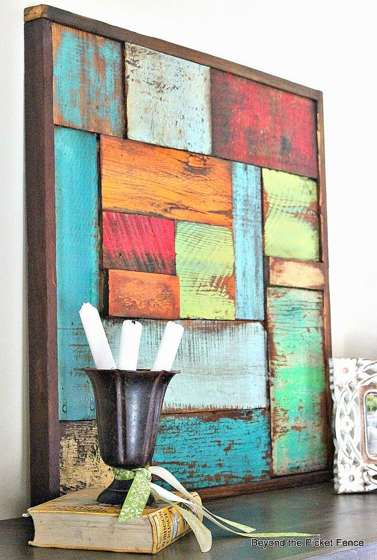 Salvaged Wood Art...I like the candles stacked in the vase.