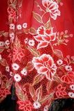 Photo: Red Kebaya cloth with white flowers