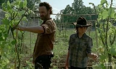 Rick (Andrew Lincoln) picks peas with Carl (Chandler Riggs) rather than tell Daryl (Norman Reedus) about Carol (Melissa McBride) in AMC's Th...