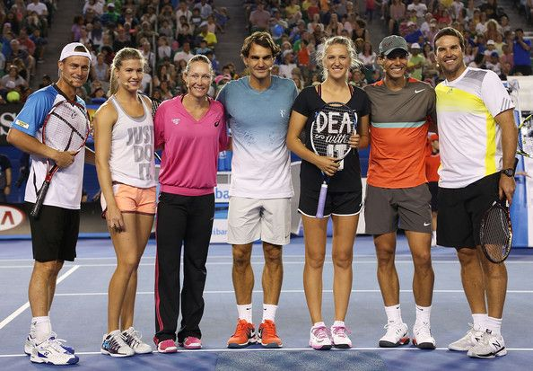 Victoria Azarenka - 2014 Australian Open Previews.  (L-R) Lleyton Hewitt, Eugenie Bouchard, Samantha Stosur, Roger Federer, Victoria Azarenka, Rafael Nadal and Pat Rafter pose following the Rod Laver Arena Spectacular as part of Kids Tennis Day ahead of the 2014 Australian Open at Melbourne Park on January 11, 2014 in Melbourne, Australia.