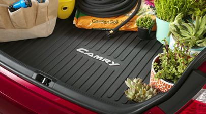 Toyota Camry Cargo Tray - Black / With Logo  Molded from a tough, flexible polymer blend that's easy to clean Skid-resistant surface helps keep cargo from sliding around Perimeter lip helps contain spills, debris and liquids Designed to fit the vehicle's trunk floor Features embossed vehicle logo. Get it at www.premiertoyota.com or call 440-985-6100
