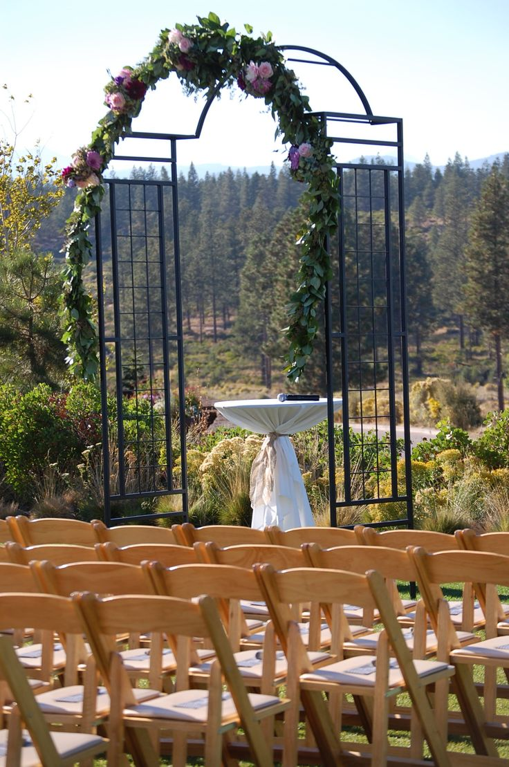 an Arbor we made for a wedding in Bend Oregon last fall. They did an amazing job with the garland. Thanks for sharing