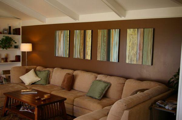Wohnzimmer Gestalten - Dekokissen Gemälde An Der Wand Braune ... Braune Wand Wohnzimmer