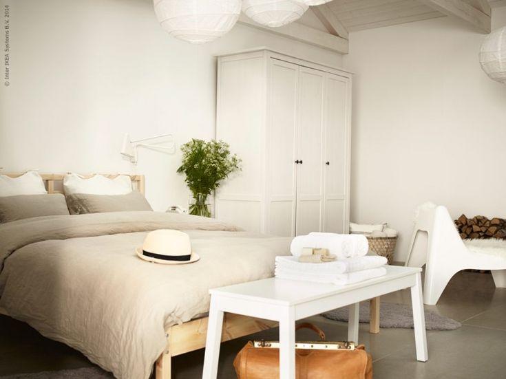TARVA bed frame 799 kr, SIGURD bench 599 kr, LINBLOMMA duvet covers 699 kr in linen with 2 Pillowcases, IKEA PS 2012 LED wall light 499 kr, HEMNES wardrobe 2995 kr, IKEA PS Vago armchair 249 kr.