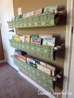 Use double curtain rod brackets to hang custom boo by Sabrina Scanlan Grotefend