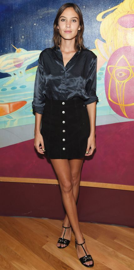 Alexa Chung hit the 45th Anniversary of Electric Lady Studios in separates from her AG collection, featuring a silky long-sleeve printed blouse and a '70s-style button-front mini, and styling them with patent black T-strap sandals.