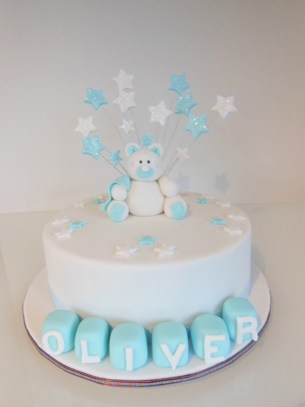 Pale Blue Christening cake with handmade teddy figurine and name blocks  www.enticingcakes.com.au  https://www.facebook.com/pages/entICING-cakes/446691245352652?ref=hl