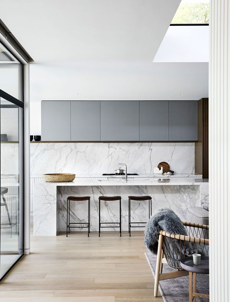 In desperate need of some love and care, this mid-century home in Melbourne's leafy east has a new lease of life. Mim Design connected spaces making the home light, bright and welcoming, while retaining the integrity of the interior mid-century features that are all too often lost. Once closed rooms are now high traffic hubs. The open-plan kitchen area is…