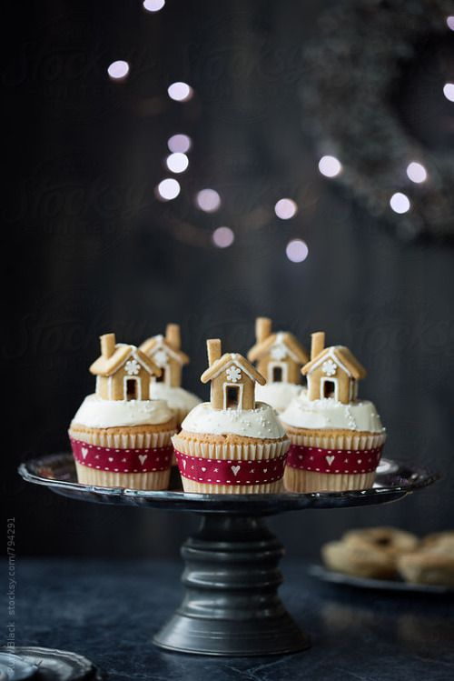 dreamsofchristmas: roldam: Gingerbread house cupcakes By RuthBlackAvailable to license exclusively at Stocksy Christmas Blog! All Year! 365 Days! New posts every 5 minutes!