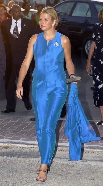 She is making a trendy statement! Wonderful color, but the lining could be better: her neckline should be a V-one and her shoulders should be covered in order to create body balance.