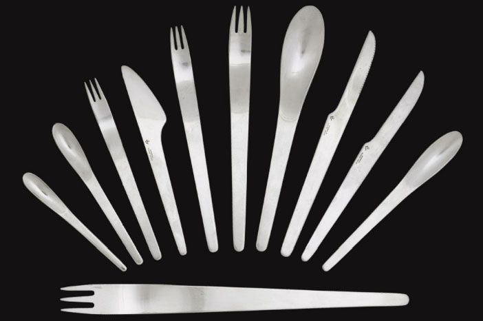 """Modernist """"AJ"""" stainless steel flatware, comprising 77 total pieces packed in a teak storage case - for A. Michelson, Denmark - 1957 - designed by Arne Jacobsen."""