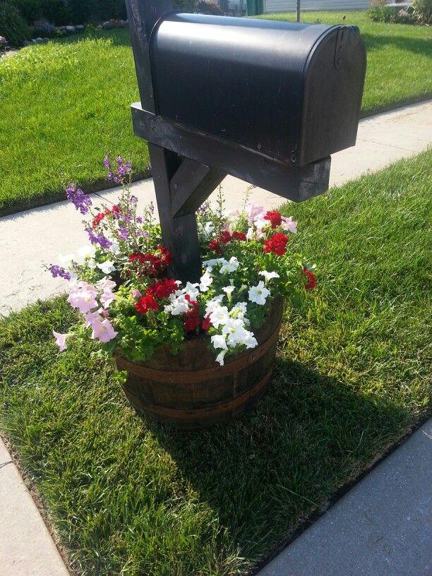 whiskey barrel filled with flowers around mailbox garden love pinterest whiskey barrels
