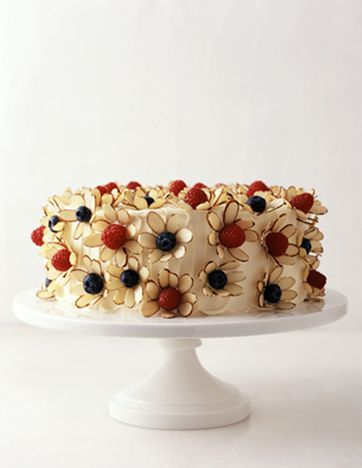 Almond slivers with raspberries and blue berries as flowers. Cake decorating idea.