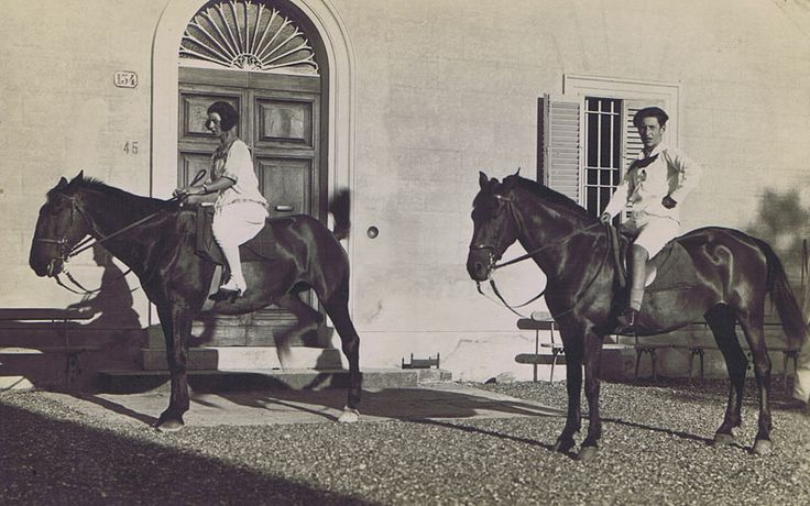 Couple riding in front of the Villa.
