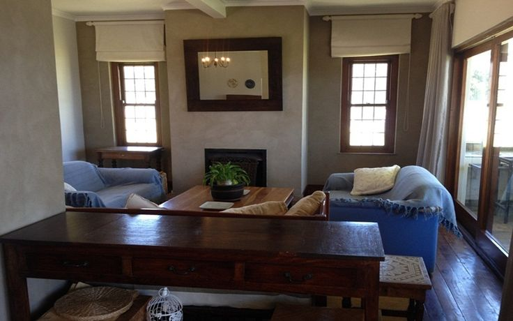 The Nook: Living Area/Lounge. FIREFLYvillas, Hermanus, 7200 @fireflyvillas ,bookings@fireflyvillas.com,  #TheNook  #FIREFLYvillas # HermanusAccommodation
