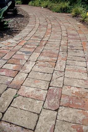 Brick paved path leading down garden