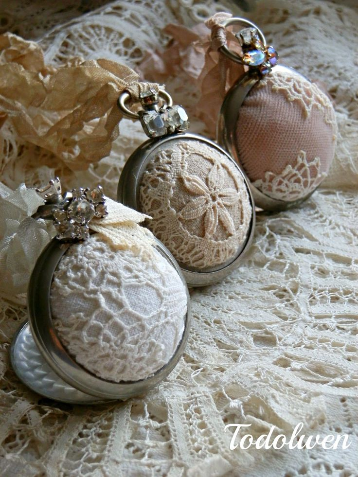 Todolwen (new): Sew Much Time : made out of a pocket watch casing.  It has a cover, so when it is open, the pin cushions stand.