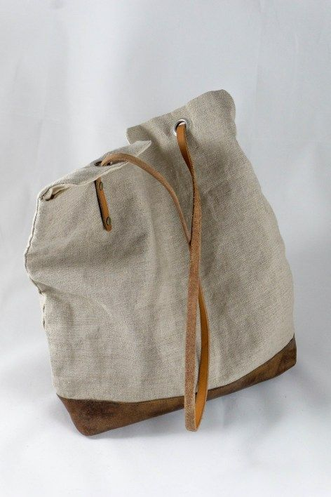 Leather and linen self-closing tote bag