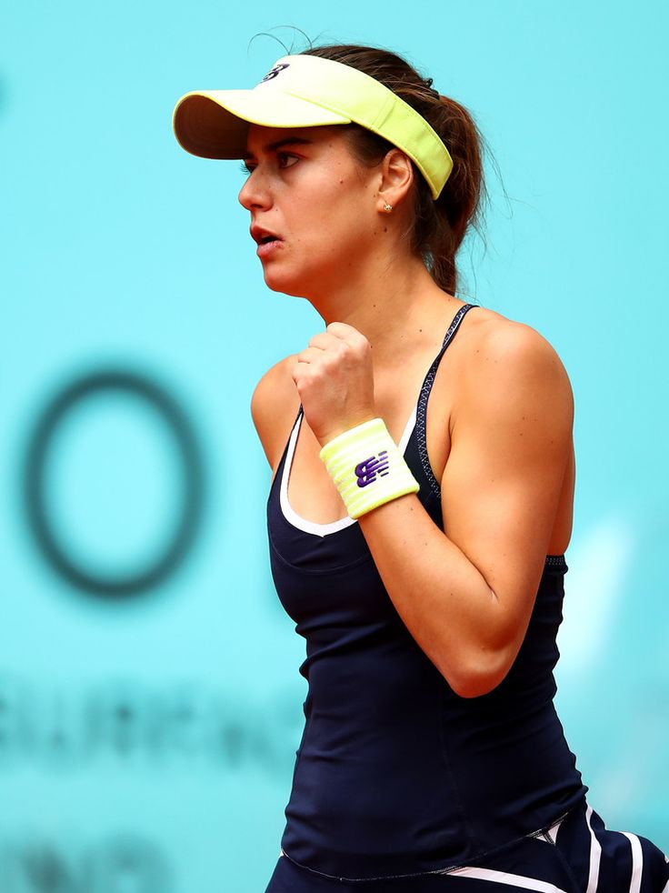 Sorana Cirstea of Romania celebrates winning the first set against Dominika Cibulkova of Slovakia in their quarter final match match during day six of the Mutua Madrid Open tennis tournament at the Caja Magica on May 05, 2016 in Madrid,Spain (Source: Clive Brunskill/Getty Images Europe)