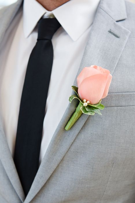 Subtle hidden Mickey on a Walt Disney World groom's rose boutonniere