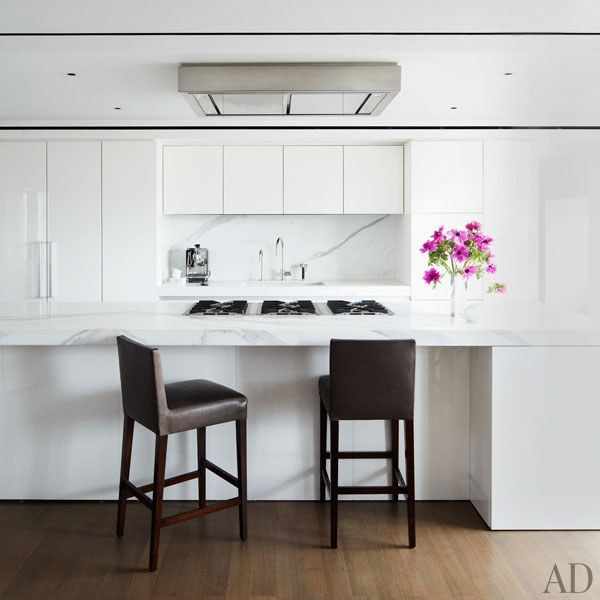 An almost all white kitchen featuring Calacatta marble and Boffi cabinetry | archdigest.com