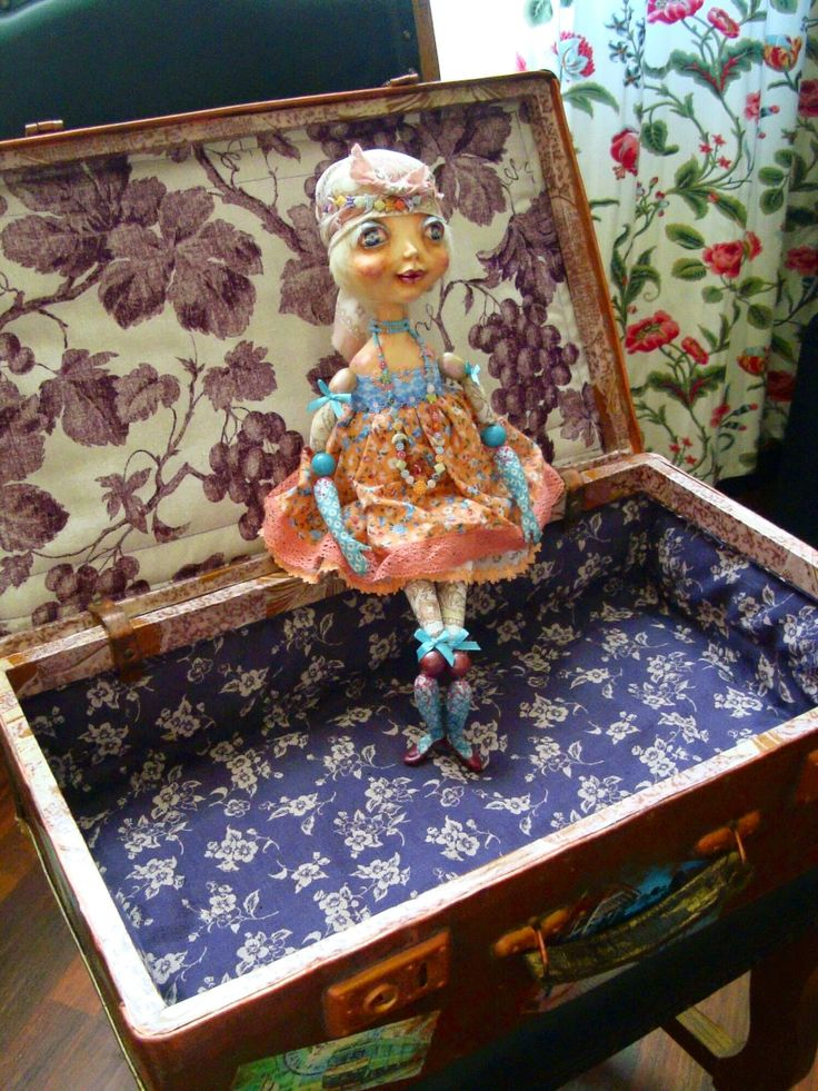 BECKIE is sitting in a newly-decorated old luggage