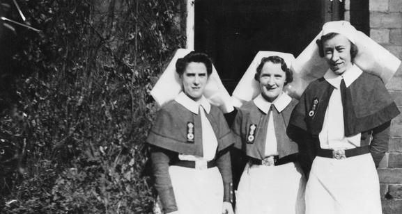 FOUR NAVAL NURSES WHO RISKED THEIR LIVES REMOVE PATIENTS FROM BOMBED HOSPITAL DURING... (A 12987) (FROM THE COLLECTIONS AT LONDON'S IMPERIAL WAR MUSEUM)