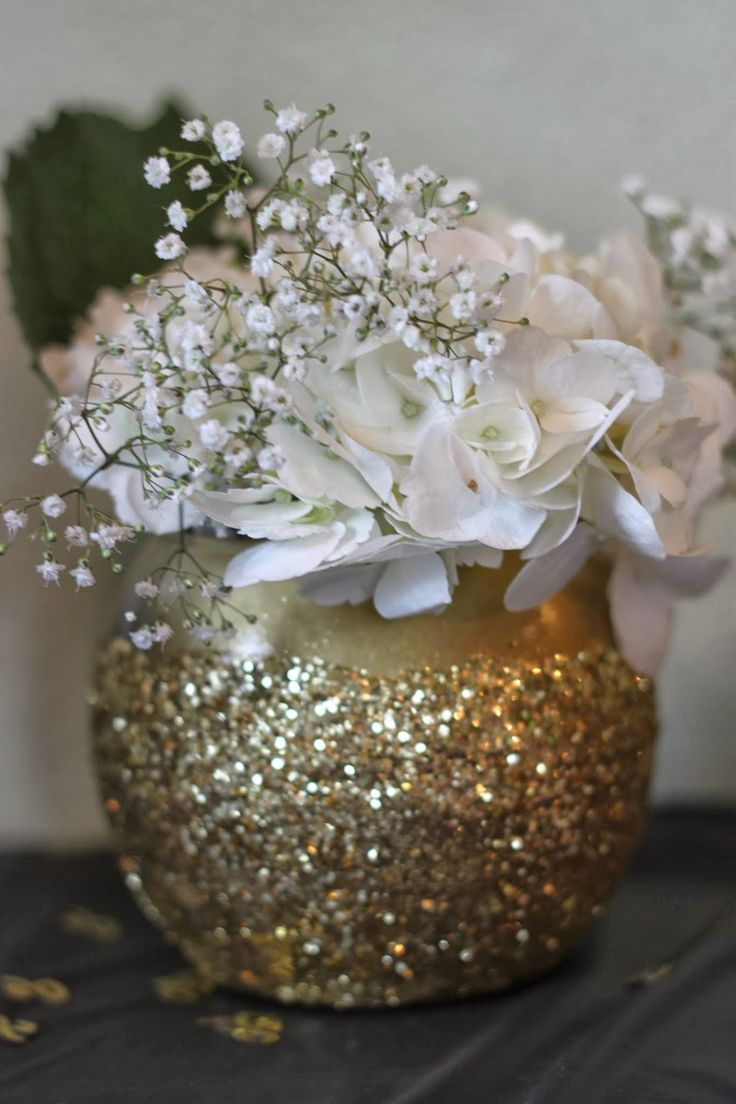 White flowers in a gold glitter vase! black and gold 50th birthday party by my dirty aprons blog.