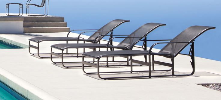 Chaise Lounges Overlooking A Beautiful Ocean View The