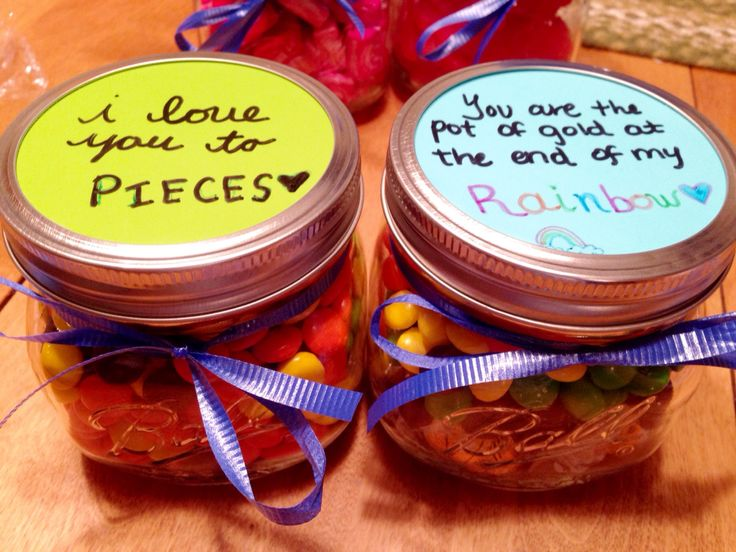 "Jar of Reese's Pieces and jar of Skittles with gold wrapped candy at the bottom of the ""rainbow."" Sweet and lovely gift for your boyfriend or girlfriend for any occasion!"