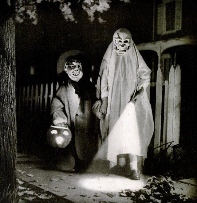 Notice they're holding hands. When I trick-or-treated in the 50's & 60's, Mom insisted on the same...& THEN, we went out during dark!