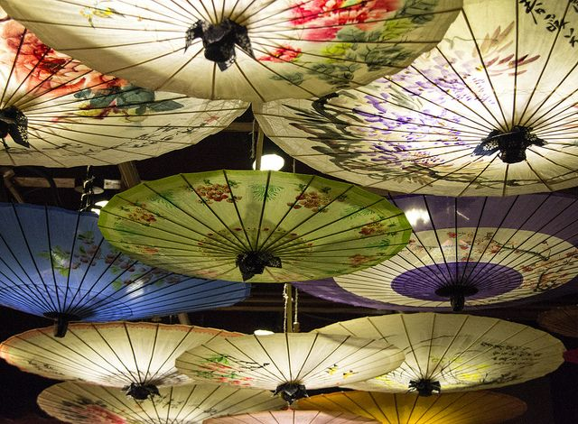 These umbrellas dazzle in amazement as they hang from the ceiling #hangzhou #china. Upside down umbrella, are they using them to decorate the light?