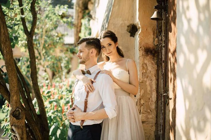 Bride and groom. Groom outfit, wooden bowtie and  leather suspenders. Grey tulle wedding skirt.