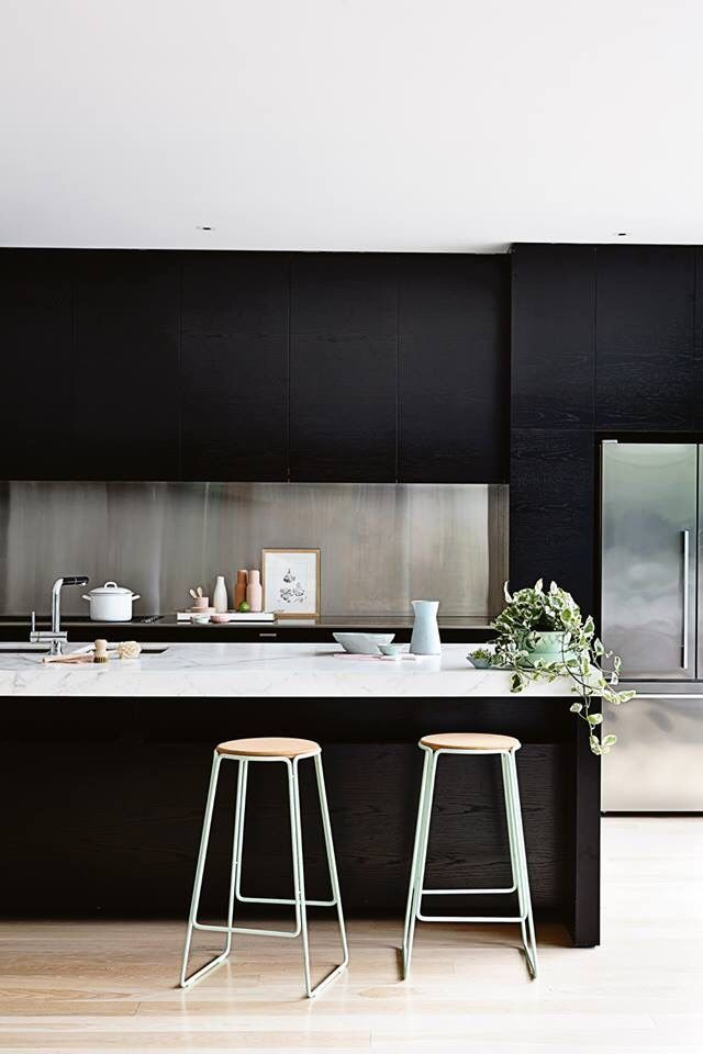 Kitchen with black cabinets.