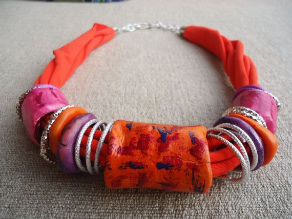 Handmade and handpainted necklace. Original tubes and clay rings.