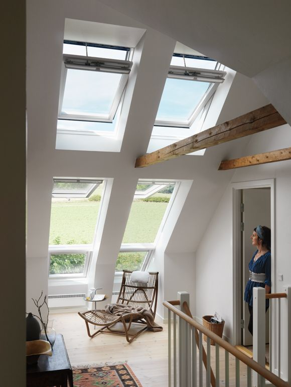 Six large roof windows bring daylight and fresh air into this beautiful space. They open up the room to the outside and provide stunning views – and they create a unique living area in what was once little more than a landing.