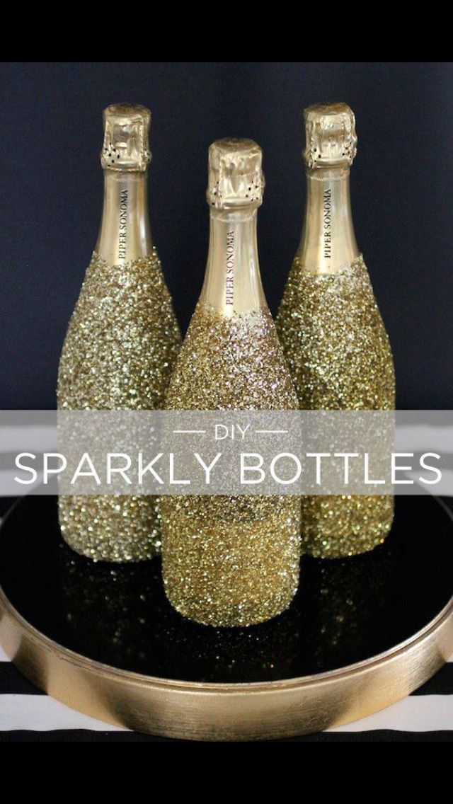 D.I.Y sparkly bottles... All you need are the bottles, glue and glitter! Simple yet affective