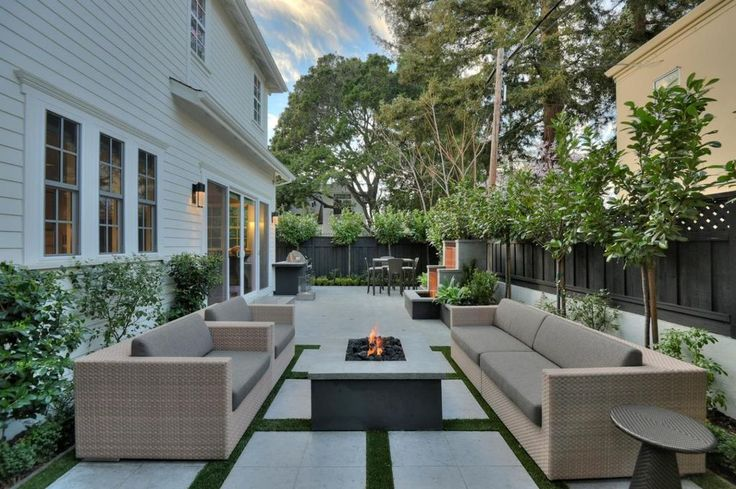 Transitional Patio with Outdoor kitchen, Fire pit, Trellis, Fence, exterior stone floors, Raised beds