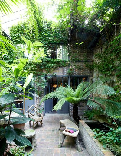 internal courtyard garden, filled with palms and tropical plants.