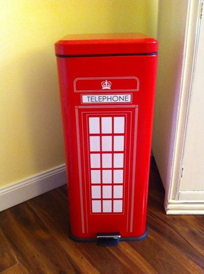 London Telephone Booth Trash Can Being Used As A Hamper