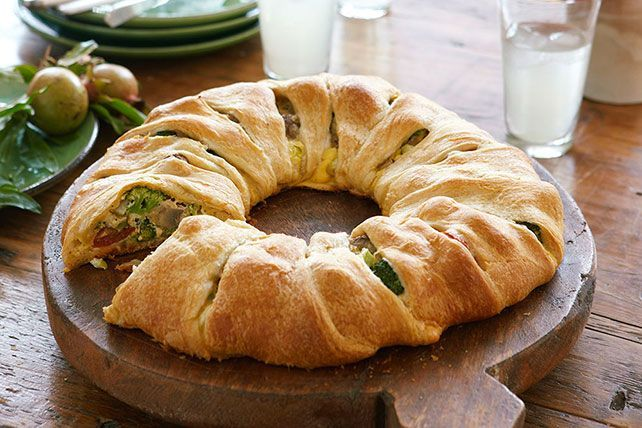 Try a new take on a crescent roll ring with this Easy Baked Cheese & Vegetable Twist. This crescent roll ring recipe will be a hit at your holiday party.