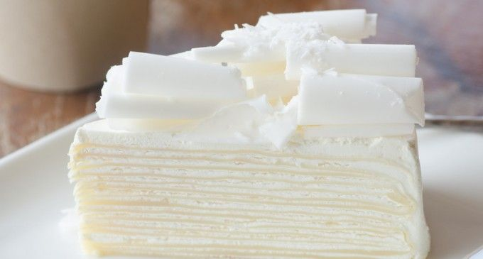 White Almond Cake - the secret ingredient is the extract..I wish they told us how to make it look this way though.
